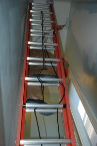 Here I am (behind the ladder) paint the blue-aqua on the staircase.